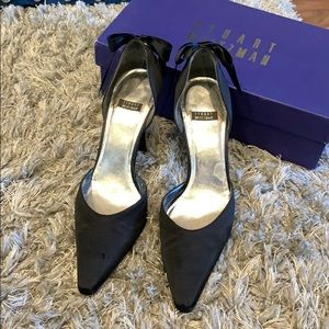 Black satin high heels with satin bow in back